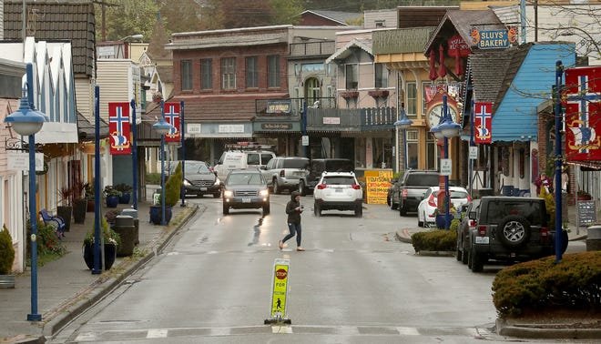 A pedestrian crosses Front Street in downtown Poulsbo in April. Poulsbo's demographics mirror that of Kitsap County, with about 80% of the city made up of white residents. At a forum Tuesday, members of minority communities talked about instances in which they have not felt welcome while living or working in the city.