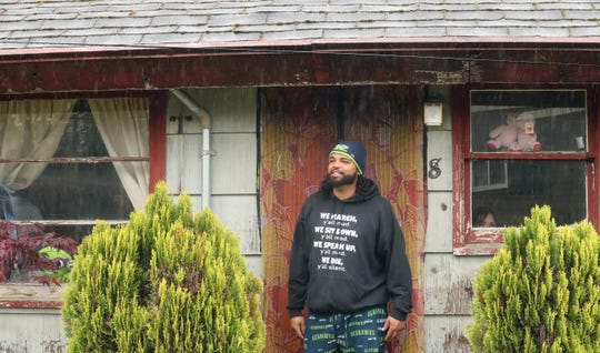 Tremayne White on the front stoop of his Bremerton home on Wednesday April 22, 2020.