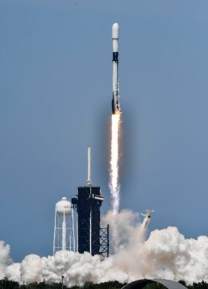 A SpaceX Falcon 9 rocket launches 60 Starlink internet satellites from Kennedy Space Center's pad 39A on Wednesday, April 22, 2020.