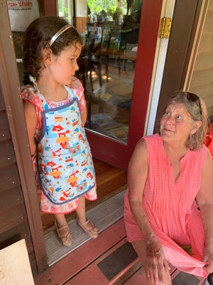 """Beth Kiendl, a retired nurse in Brattleboro, finds being separated from her grandchildren the hardest part of the coronavirus pandemic. Pictured here: Grace with her Minga, before the pandemic. """"Grace and I are very tight,"""" Kiendl said. """"That's been tough, tough, tough."""""""
