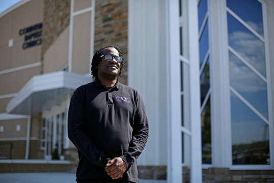 Minister Bomani Tyehimba poses in front of the Corinthian Baptist Church in the Bond Hill neighborhood of Cincinnati on Wednesday, April 22, 2020. Tyehimba recently helped lead a voter drive through his church to encourage more people from the area to vote.