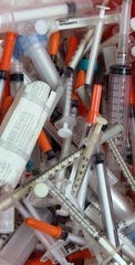 Discarded needles found along streets and roads in Northern Kentucky prior to needle-exchange operations starting.