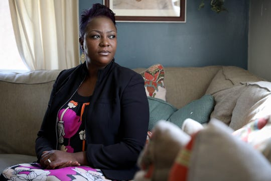 Ebony Pickens, pictured Tuesday, April 21, 2020, at her home in Finneytown. She is the mother of a man who they believe contracted COVID-19 while incarcerated in a federal prison. Pickens' son, 26-year-old Dmil Polley, is one of about 2,400 inmates at Federal Correctional Institution Elkton, where earlier this month Ohio Gov. Mike DeWine sent the National Guard to assist medical staff in the prison's infirmary.