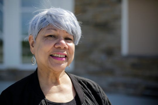 Renee Ross, 69, of Silverton, poses in front of the Corinthian Baptist Church in the Bond Hill neighborhood of Cincinnati on Wednesday, April 22, 2020. Ross recently joined in a voter drive led by the church, and believes vote-by-mail should be implemented permanently.