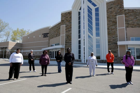 Minister Bomani Tyehimba poses with members of his church who recently volunteered in the voter drive in front of the Corinthian Baptist Church in the Bond Hill neighborhood of Cincinnati on Wednesday, April 22, 2020. Tyehimba recently helped lead a voter drive through his church to encourage more people from the area to vote.