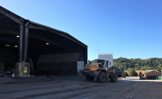 A front loader operates at Covington's trash transfer station at 4397 Boron Drive. The city has proposed selling the aging station in the Latonia neighborhood to Rumpke for $8 million.