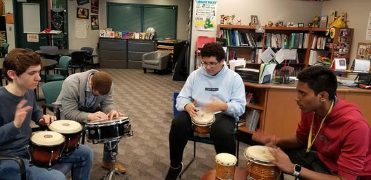 Middlesex County Academy for Science, Mathematics and Engineering Technologies participate in a drum circle.