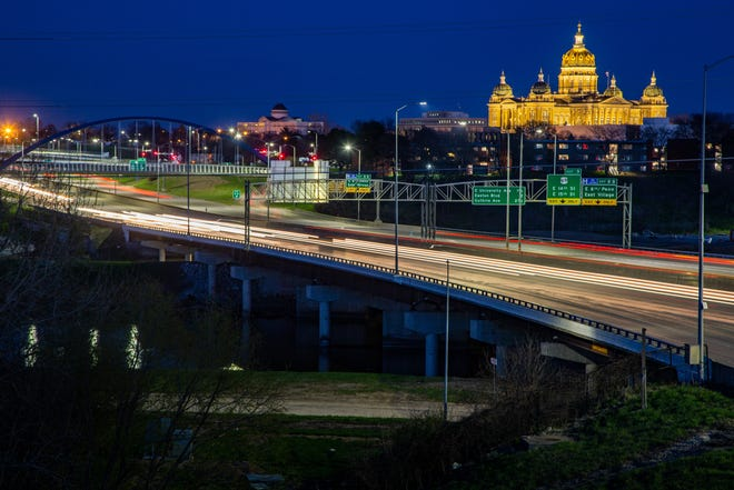Cars streak along I-235 on April 21, passing downtown and the State Capitol building. State and local law enforcement agencies have seen a sharp spike in drivers going more than 100 mph since mid-March when traffic decreased amid the coronavirus pandemic.