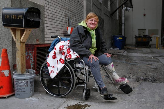 Heather Green, a homeless resident of Des Moines, poses for a photo in an alleyway on 6th Ave in Des Moines on Wednesday, April 22, 2020.