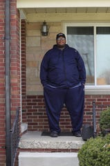 Detroit Fire inspector Najuma Fulton is in quarantine at his home on Monday in Warren.