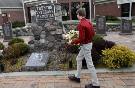 Ian Kramp, 14 of Allen Park and an 8th grader at Boyd W. Arthurs Middle School in Trenton walks up to lay a wreath at the Trenton Veterans Memorial on Wednesday, April 22, 2020.Kramp, couldn't do his school's field trip to Washington DC where he was to lay a wreath at the Arlington National Cemetery because of the Coronavirus COVID-19.He wanted to find a way to honor veterans anyway and chose to do it this way.