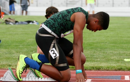 Isaiah Simmons was a two-time Kansas high school long jump champion growing up in Olathe, Kansas.