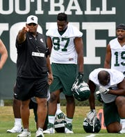 Ron Burton is one of two holdovers from Mark Dantonio's coaching staff last season at Michigan State. He is the Spartans' defensive line coach.