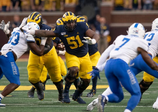Former Michigan center Cesar Ruiz (51) could be a first-round selection in the NFL Draft.