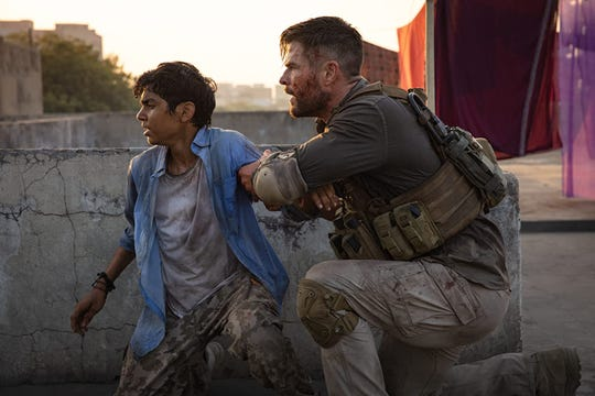 "Rudhraksh Jaiswal and Chris Hemsworth in ""Extraction."""