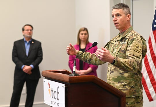 Gen. Joseph M. Martin, U.S. Army Vice Chief of Staff,  speaks about the alternate care facility for COVID-19 patients at the TCF Center in Detroit with Sen. Gary Peters and Rep. Elissa Slotkin on Wednesday, April 22, 2020.