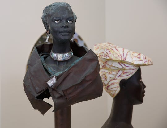 """Two sculptures by German artists: Fritz Koenig's """"Bust of an African Woman"""" (left) and Luise Kimme's """"Marianne,"""" both in """"Queen"""" at the Charles H. Wright Museum of African American History. Some images from the show are up at thewright.org."""