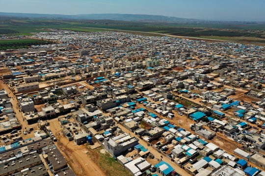 This April 19, 2020 photo shows a large refugee camp on the Syrian side of the border with Turkey, near the town of Atma, in Idlib province, Syria.
