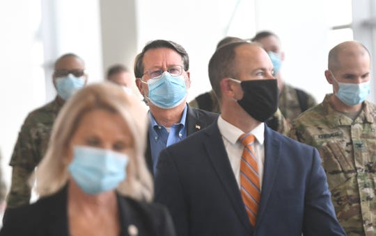 Sen. Gary Peters (center) arrives for a news conference after a tour of the alternate care facility for COVID-19 patients at the TCF Center in Detroit on Wednesday, April 22, 2020.