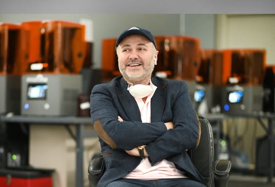 Al Siblani, founder and CEO of Envision TEC, sits among many 3D printers making flexible nasal swabs at his Dearborn plant on Tuesday, April 21, 2020.