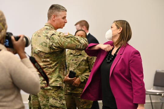 Gen. Joseph M. Martin (left), U.S. Army Vice Chief of Staff,  bumps elbows with Rep. Elissa Slotkin at the alternate care facility for COVID-19 patients at the TCF Center in Detroit  on Wednesday, April 22, 2020.