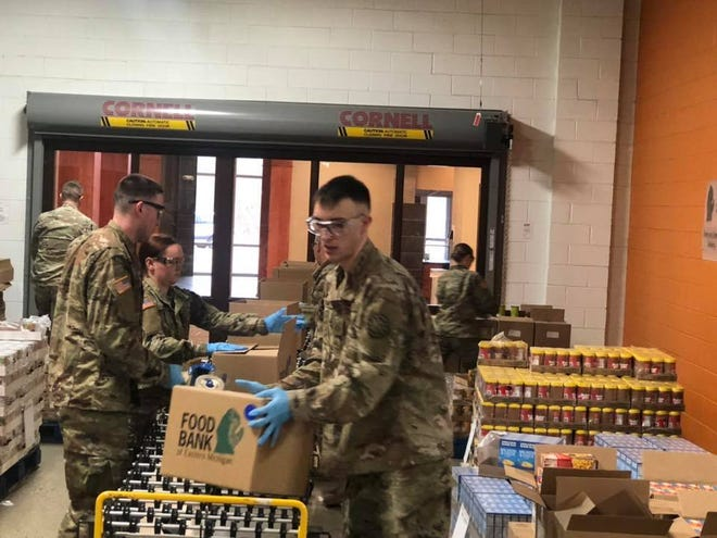 National Guard personnel helped the Food Bank of Eastern Michigan, part of the Food Bank Council of Michigan, sort items for distribution last month in Flint.