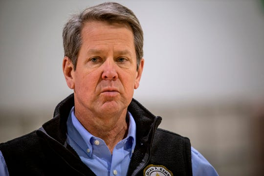 FILE - In this April 16, 2020, file photo, Georgia Gov. Brian Kemp listens to a question from the press during a tour of a temporary hospital at the Georgia World Congress Center in Atlanta.