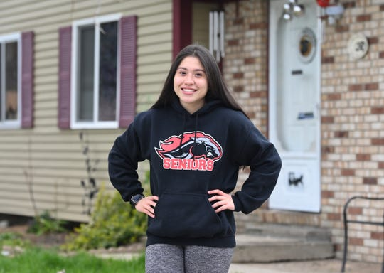Troy High School senior Heidi Garay stands outside her Troy home on Wednesday, April 22, 2020. Garay was planning to visit the college campuses of Central Michigan University and Western Michigan University one last time to help her decide where she would attend in the fall. Garay, may scrap those universities and stay home because of the coronavirus outbreak and attend Oakland University.