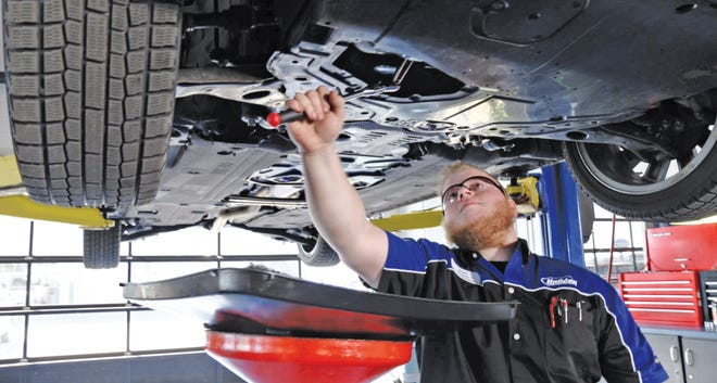Holiday Mazda is offering free oil changes for health care workers through May 4. Pictured is Team Holiday Technician Jacob Wagner.