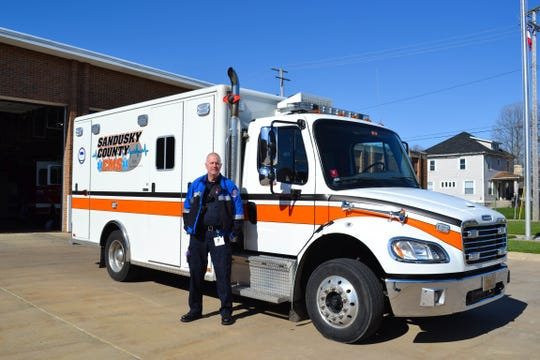 Chris Shay stands next to one of the ambulances that connected him over and over with people in need during his years as a paramedic. The ambulance sits outside the Fremont's Central Fire Station, where Sandusky County EMS is based.