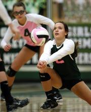 Fort Myers High School's Kenzi Gustason returns a serve against Riverdale on Friday, Oct. 25, 2012 at Fort Myers High School.