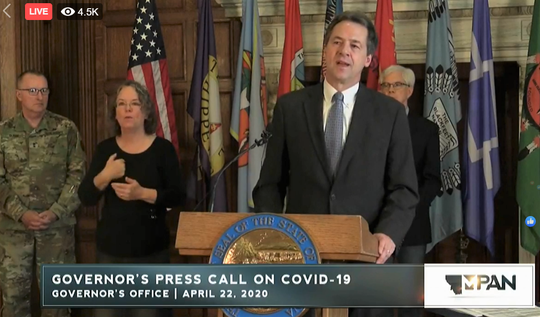 Gov. Steve Bullock discusses his plan to reopen Montana on Wednesday during a news conference.