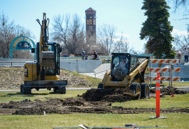 Missouri River Trucking and Excavating works on new walkways around Elk's Riverside Park Tuesday, April 21, 2020.