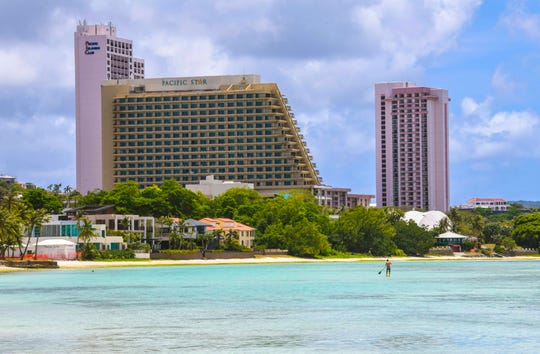 A lone paddleboard finds no difficulty in practicing social distancing as he is one of only a few people in the waters of Tumon Bay on Wednesday, April 22, 2020.