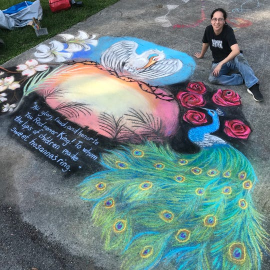 Artist Sonia Summers poses by her driveway art meant to bring joy to the people of Broadacres as they walk by.