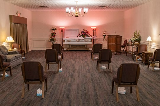 Chairs are spaced 6 feet apart with boxes of tissues placed underneath before the start of a visitation and ceremony at Owen Funeral Homes on Dixie Highway for Barbara Wilding, who was 81 when she died of COVID-19 on Monday morning in Louisville.