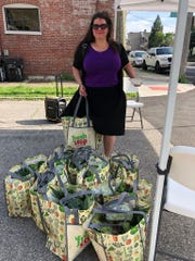 Emily Smith from Smoketown Family Wellness picking up shares for the clinic at the Shelby Park Neighborhood Fresh Stop Market.