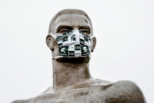 Sparty wears a Spartans mask on Wednesday, April 22, 2020, on the Michigan State University campus in East Lansing. No new coronavirus deaths were reported in the Greater Lansing area Saturday, and the number of positive cases in Ingham, Eaton and Clinton counties passed 750.