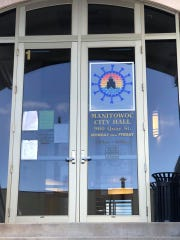 """In Manitowoc,Amanda Baryenbruch, administrative support specialist for the city, helped """"Share the Love"""" with a handmade heart craft that is now on display on the door of the main entrance of City Hall, 900 Quay St."""
