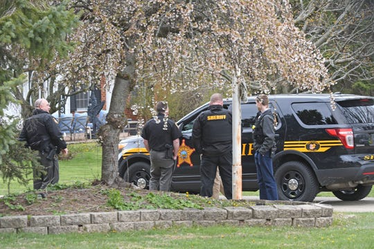 Law enforcement gather outside a home at 2210 Alta West Road on Wednesday after locating a missing 15-year-old Springfield Township boy, who ran away from home.