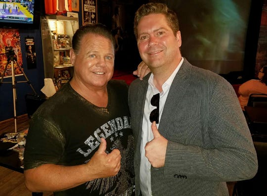 Travis Scott Bowden (right) poses with longtime friend and former client Jerry Lawler (left)