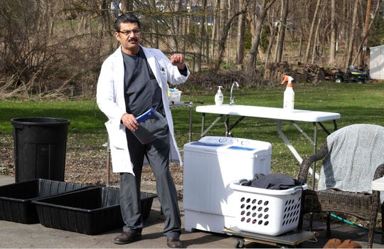 Dr. Abbas Ali, a pulmonary ICU doctor who treats COVID-19 patients, has a very rigid protocol for protecting himself and his family from the virus including social distancing. He bought a new washer and dryer to keep outside his garage, added an outside sink and limits his movements in the house.