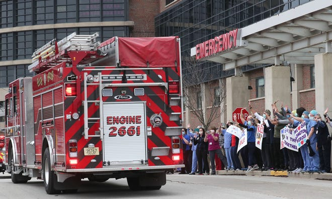 A parade of vehicles in April drove past ProHealth Waukesha Memorial Hospital in Waukesha to show their support for health care workers. Like it did in the spring, hospitals, including ProHealth Care, is limiting visitors as a measure to prevent the spread of the coronavirus as Wisconsin's outbreak has worsen in recent weeks.