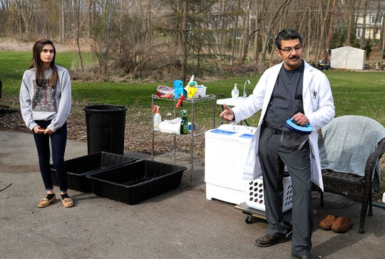 Dr. Abbas Ali, a pulmonary ICU doctor who treats COVID-19 patients, has a very rigid protocol for protecting himself and his family from the virus including social distancing. He bought a new washer and dryer to keep outside his garage, added an outside sink and limits his movements in the house. (Photo: Rick Wood / Milwaukee Journal Sentinel)