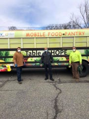 The Table of Hope Mobile food pantry bus is stocked with food for delivery to a food-distribution event in Parsippany April 17, 2020.