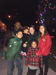 The Johnson family poses for a photo during Christmas time.