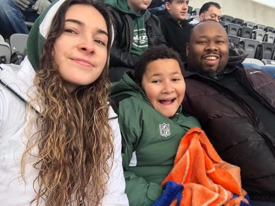 Darell enjoys a football game with his daughter Katelyn, 22 and son AJ, 13. He was known for always making time for his children.