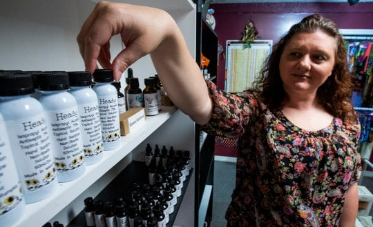 Lisa Wright, of Heady Boutique in Wetumpka, Ala., shows their hand sanitizer at the shop on Wednesday April 22, 2020.