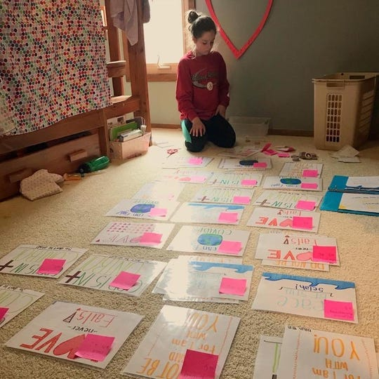Hannah Clark made about 50 posters for a fundraiser held for the staff at Ball Memorial Hospital. She raised $500.