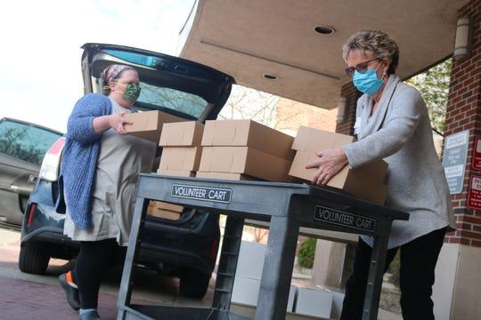Amanda Reninger, president of Sea Salt & Cinnamon, gets help from Ball Memorial staff as she delivers 1,300 cookies.
